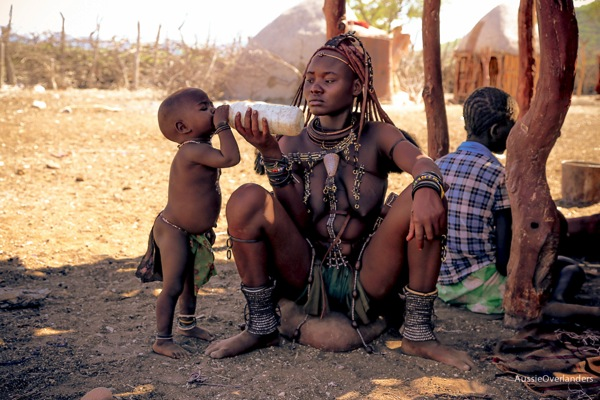 Mother feeds baby, Himba Tribe, Namibia